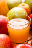 Glass of apple juice. And ripe apples Stock Image