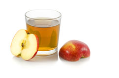Glass of apple juice with a slice of apple. On white background Royalty Free Stock Images