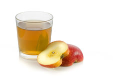 Glass of apple juice with a slice of apple. On white background Stock Photos