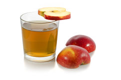 Glass of apple juice with a slice of apple. On white background Stock Image