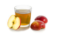 Glass of apple juice with a slice of apple. On white background Royalty Free Stock Photos