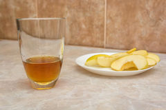 Glass of apple juice with sliced apple Royalty Free Stock Photos