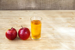 Glass of apple juice on wooden background, copyspace Stock Photo