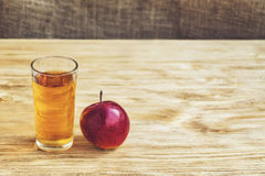 Glass of apple juice on wooden background, vintage, copyspace Royalty Free Stock Photography