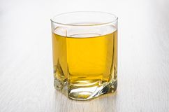 Glass of apple juice on table. Glass of apple juice on wooden table Stock Photo