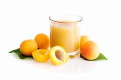 Glass of apricot juice. With apricots isolated on a white background Royalty Free Stock Photography