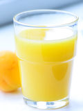 Glass of apricot juice Royalty Free Stock Images