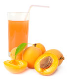Glass of apricot juice and apricots with leaf isolated on white Royalty Free Stock Image
