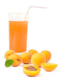 Glass of apricot juice and apricots with leaf isolated on white Royalty Free Stock Photos