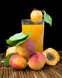 Glass apricot juice and fruits black isolated. stock photos
