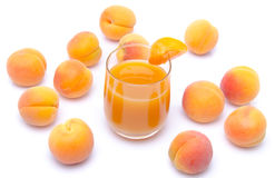 Glass of apricot juice surrounded with apricots Royalty Free Stock Photos