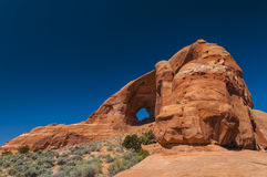 Glass Arch. Against beautiful blue sky - Utah near Moab Royalty Free Stock Images