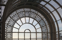 Glass arch window with metal elements. Glass arch window with patterned metal elements Royalty Free Stock Photography