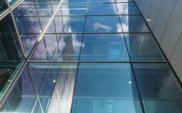 The glass architecture in city against a sky Royalty Free Stock Photography