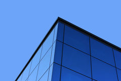 Glass architecture - detail. Blue glass construction and sky - detail Stock Image