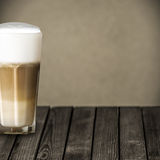 Glass of aromatic macchiato Italian coffee Royalty Free Stock Photo