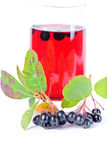 Glass of aronia juice with berries Stock Images