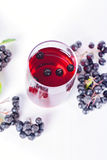 Glass of aronia juice with berries, overhead view Royalty Free Stock Image