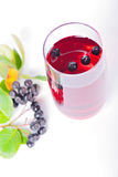 Glass of aronia juice with berries, overhead view Stock Photo