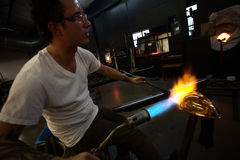 Creating Glass Art with Hot Torch Royalty Free Stock Photo