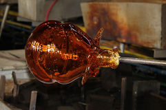 Glass Art Manufacturing. Glass being blown and rolled while hot Stock Photography