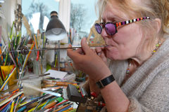 Glass Artist in her workshop Stock Photos