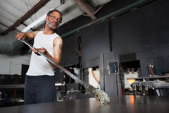 Glass Artist with Piece on Workbench Royalty Free Stock Image