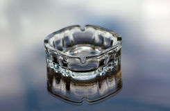 Glass ashtray like frozen water icec Royalty Free Stock Image