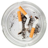 Glass ashtray with stubs. Isolated over white background royalty free stock images