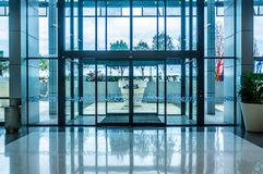 Glass automatic sliding doors entrance. Glass automatic sliding doors entrance into shopping mall royalty free stock photos