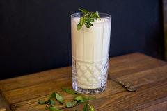 A glass of Ayran. Turkish traditional drink made of yoghurt and mint Stock Photos