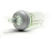Glass Baby Bottle. With green rubber teat Stock Images