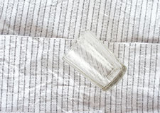 Glass on a background of crumpled DNA sequence Stock Images