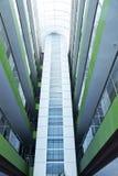 Glass balconies. Indoor glass balconies in modern building Stock Images