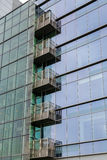 Glass Balconies in Green Glass Office Tower Royalty Free Stock Photography
