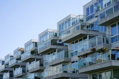 Glass balconies in a multi-storey house royalty free stock photo