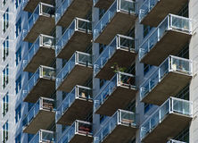 Glass Balconies on the Side of a Tall Building Royalty Free Stock Photography