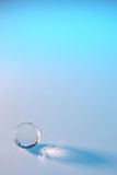 Glass ball in background. In studio Royalty Free Stock Photos