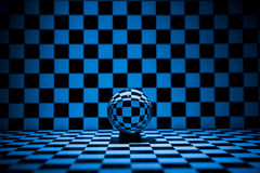 Glass ball. Blue illuminated Glass ball on a checkered background stock photos