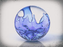 Glass ball with blue liquid Royalty Free Stock Photo