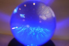 Glass ball in blue tones. Close up of glass ball in shades of blue Stock Images