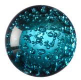 Glass ball of blue water. Macro view of clear glass ball of blue water with drops under surface; white studio background stock images