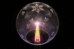 Glass ball and bright beam. 3D illustration glass ball of gray color with a pattern on top of the six-pointed star and a bright yellow balloon beam penetrating Stock Photo