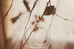 Glass ball or candlestick on a tree branch, retro toning stock photo