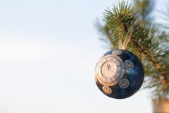 Glass ball, Christmas decoration with a clock on a Christmas tree, processing under a vintage photo, texture added, Stock Photos