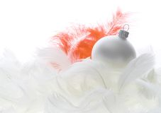 Glass ball on feathers Royalty Free Stock Image