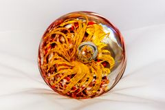 Glass ball. With yellow and red decorative elements in it Stock Photography