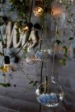 Glass ball , hanging on the wall.Inside the blue hydrangeas.Wedding floristry Stock Photos