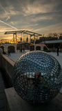 Glass ball at ice skate park. A glass ball at  the temporary ice skate park at the museum square, amsterdam, the netherlands Royalty Free Stock Image