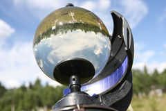 Glass ball. Instrument used in meteorology to calculate the length of the solar day and information about climate areas. Summer sunny day stock photo